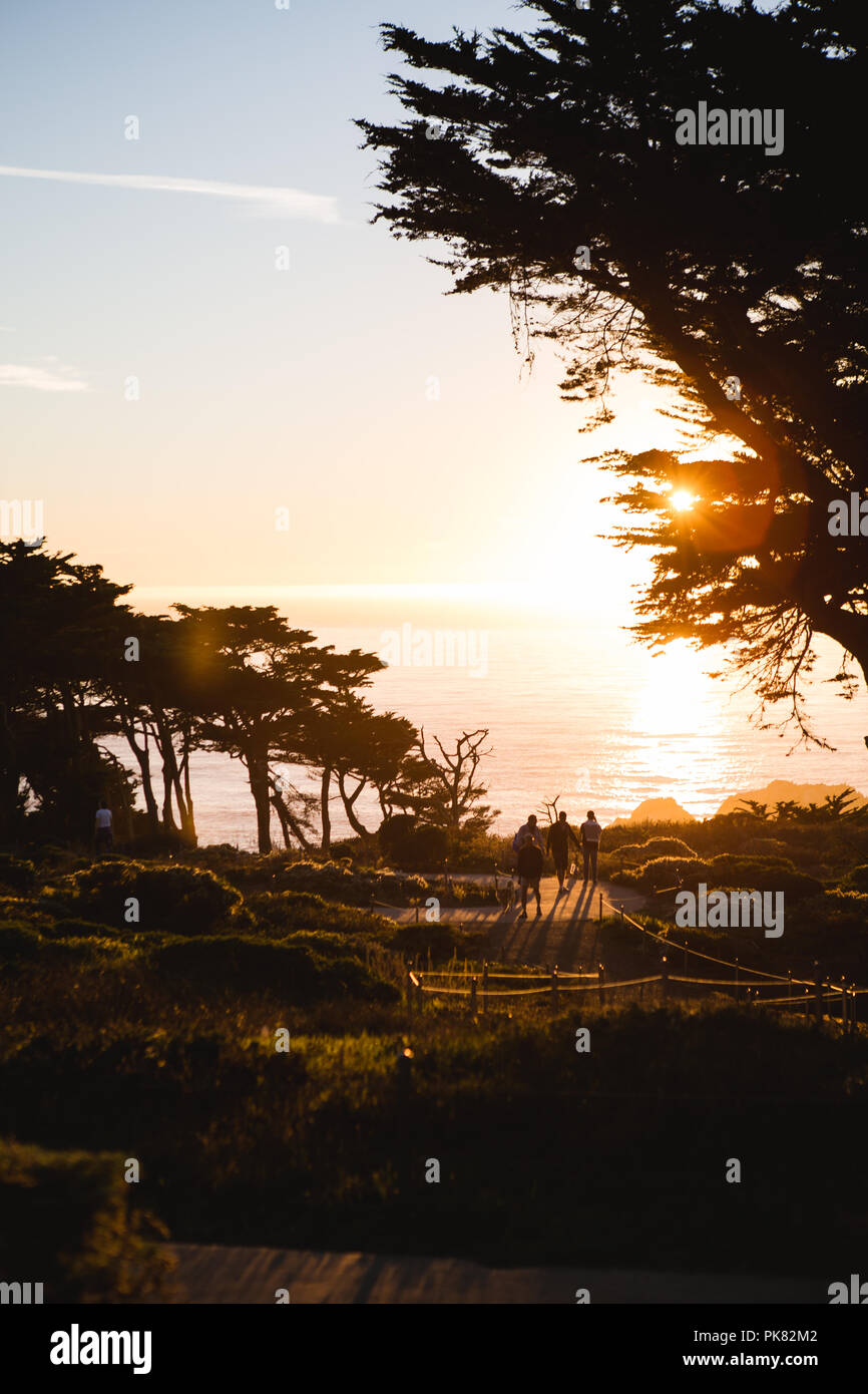 Three People Taking a Walk at Sutro Baths - Stock Image
