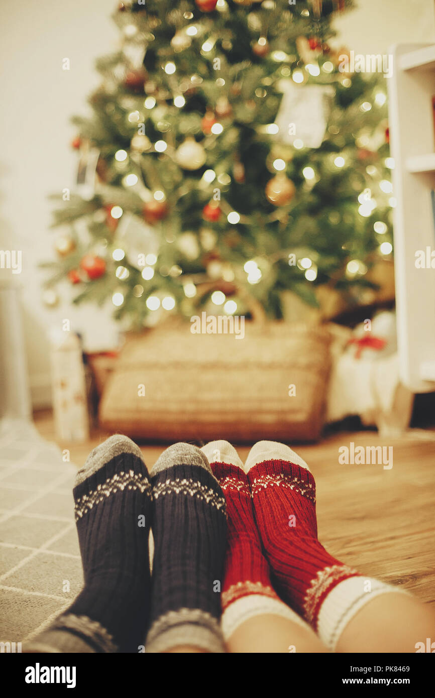 Beautiful Christmas.Family Legs In Stylish Festive Socks On Background Of Golden