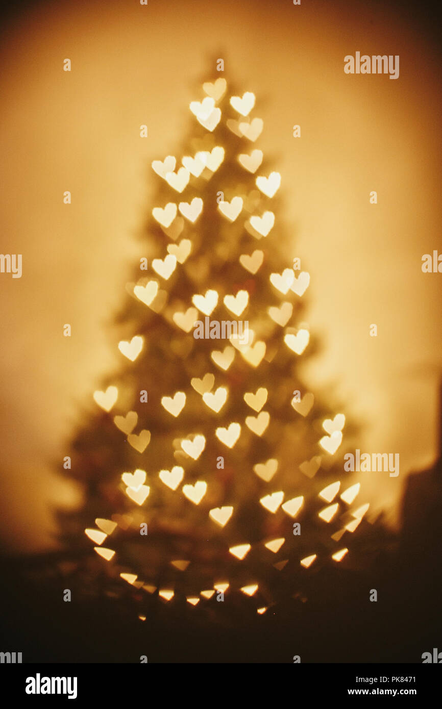 beautiful christmas tree golden lights hearts in festive room ...