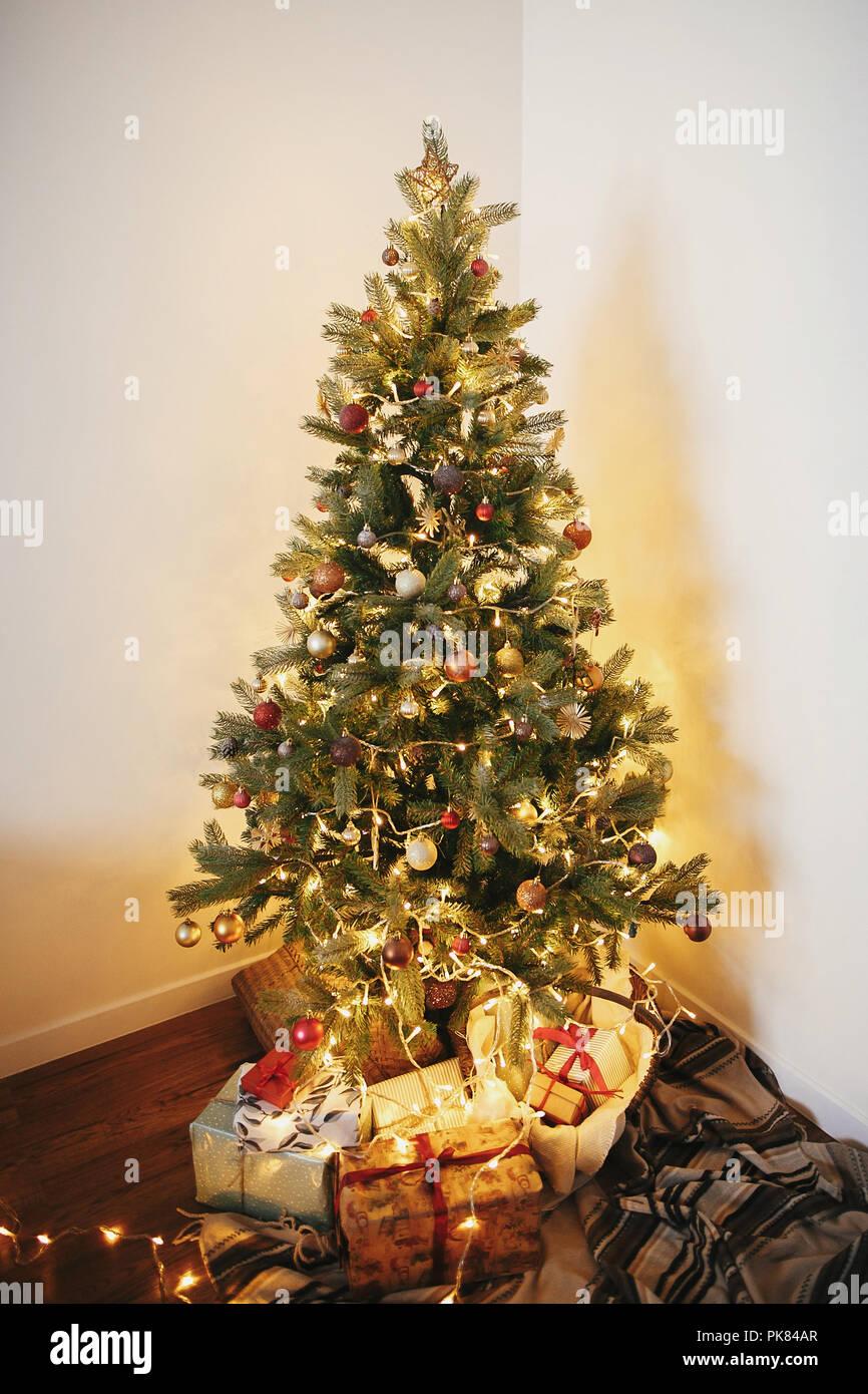 stylish christmas gift boxes under beautiful christmas tree with ...