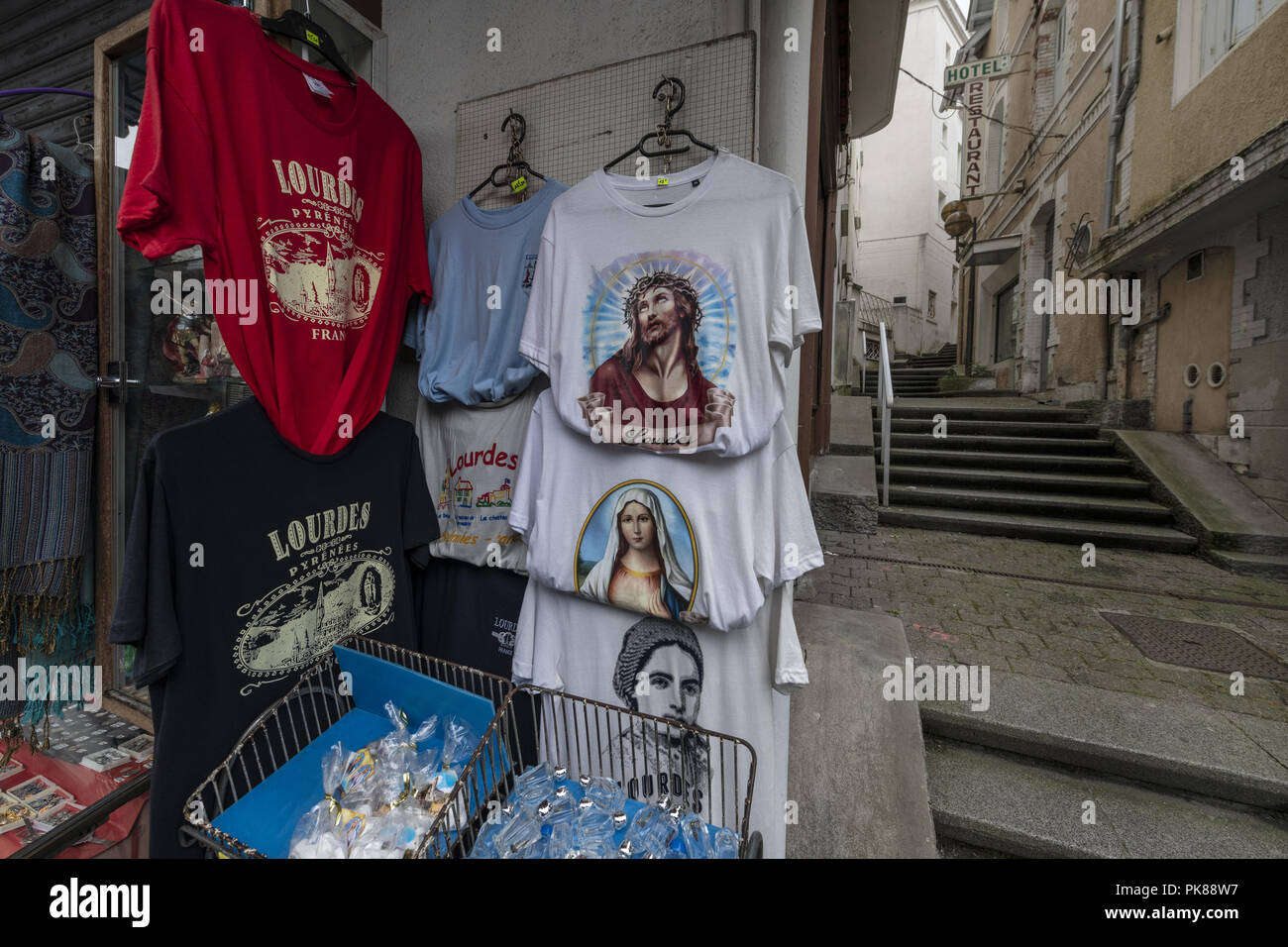 Lourdes, South of France; August 04 2018, Commercial -  Business Side of selling Religion. Lourdes Holy Water - Healing Properties. - Stock Image
