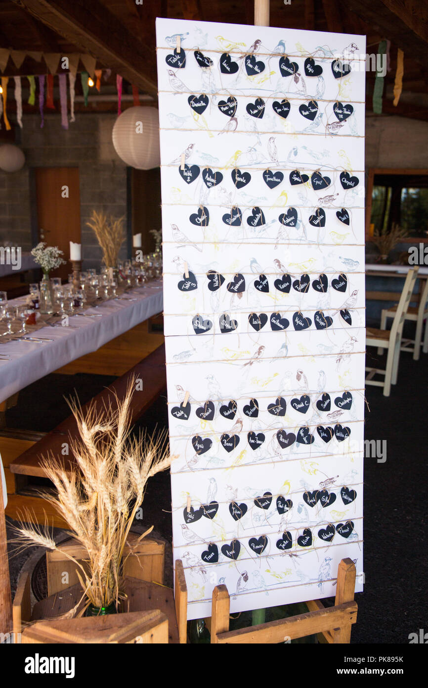 Heart Shaped Wedding Guests Paper Name Tags on Board - Stock Image
