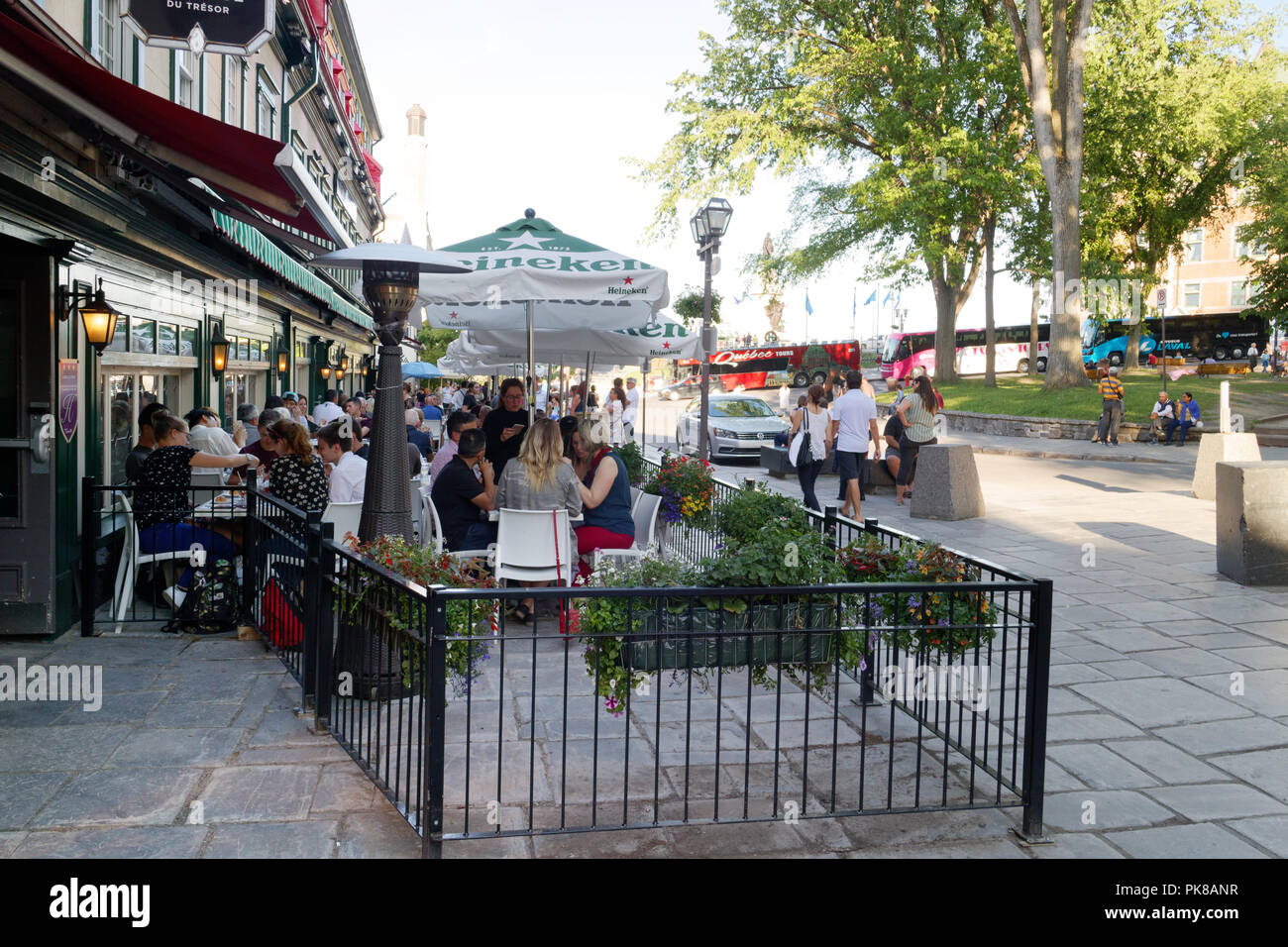 People eating on the busy tourist restaurant terrasses on Rue Ste Anne in Vieux Quebec, Canada - Stock Image