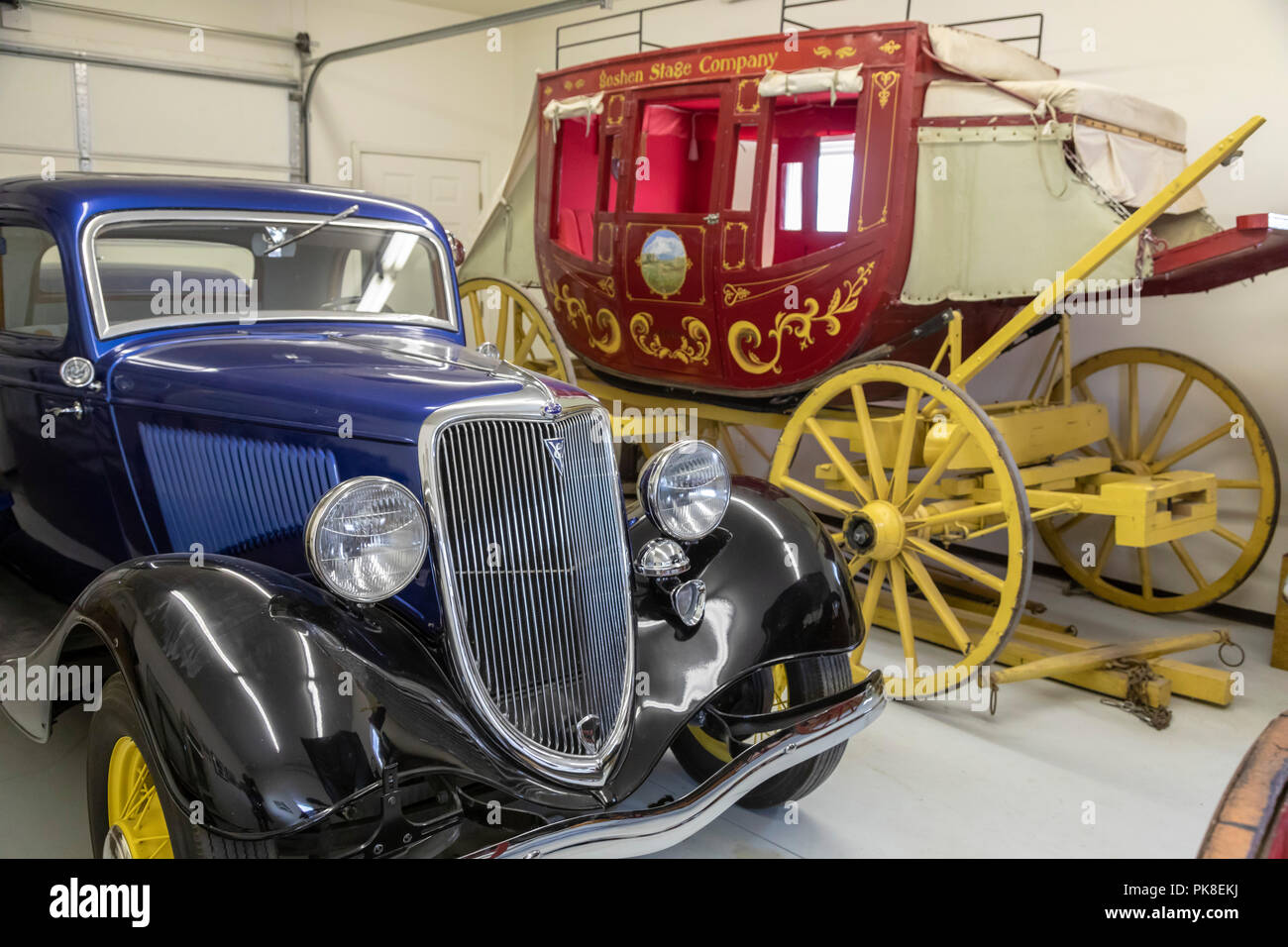 Torrington, Wyoming - A 1934 Ford Roadster and a stage coach on display at the Homesteaders Museum. The museum contains artifacts and information abou - Stock Image