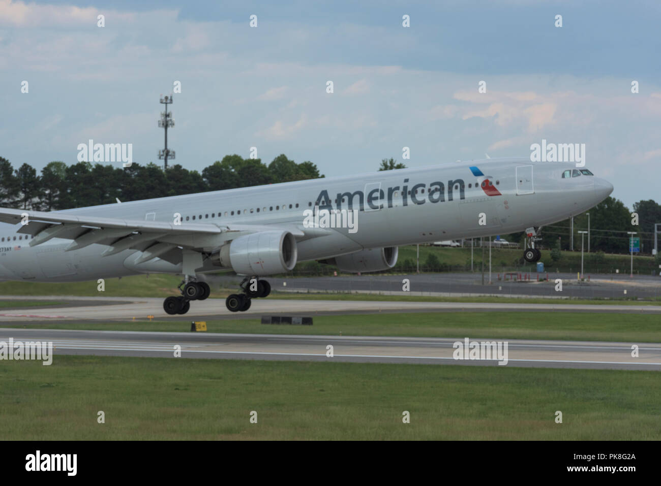 Charlotte, NC - May 14, 2017/USA: A commercial airliner begins its takeoff at Charlotte Douglas International Airport, Charlotte, NC - Stock Image