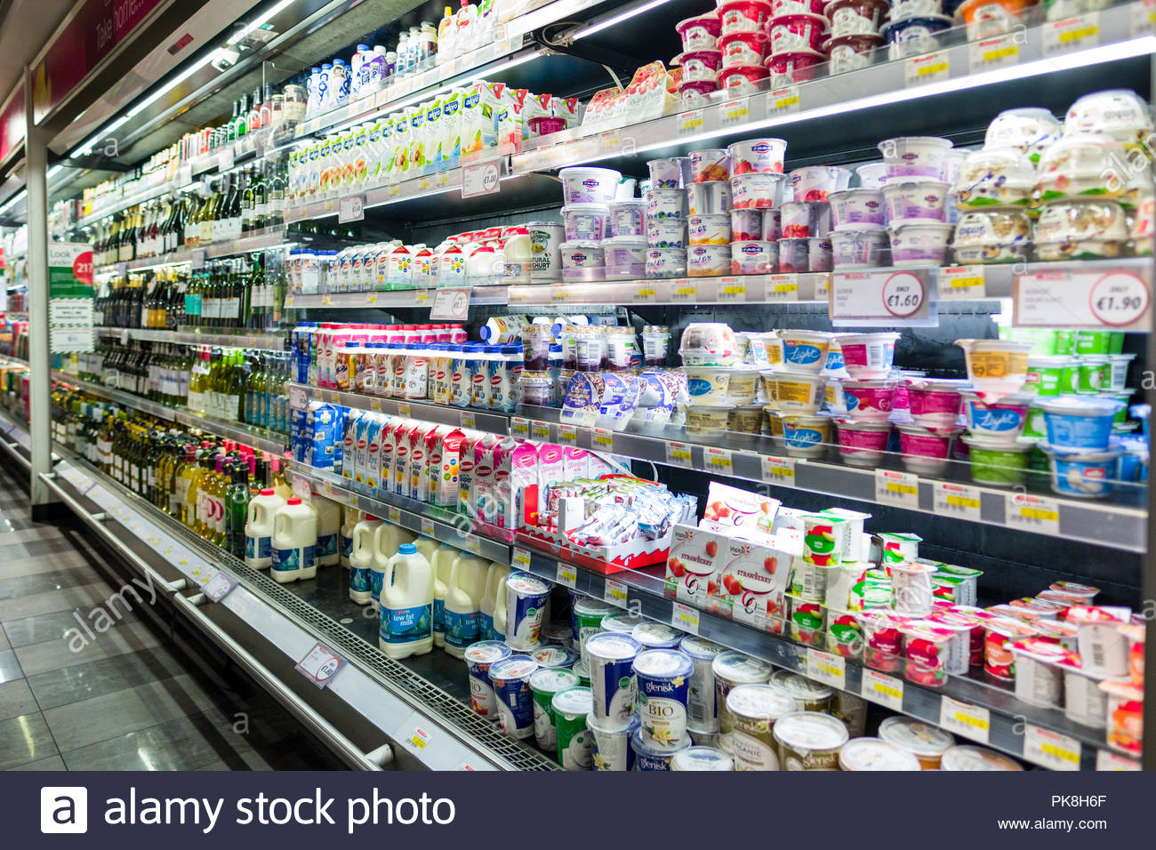 Large selection of yogurt and dairy products in refrigerated display case, Spar convenience retail shop, Merrion Row, Dublin, Leinster, Ireland - Stock Image