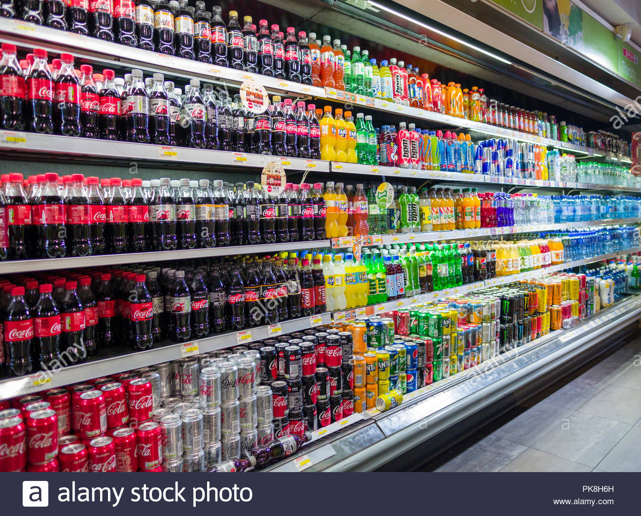 Large selection of refrigerated soft drinks in bottles and aluminum cans on sale in Spar convenience retail shop, Merrion Row, Dublin, Leinster, Irela - Stock Image