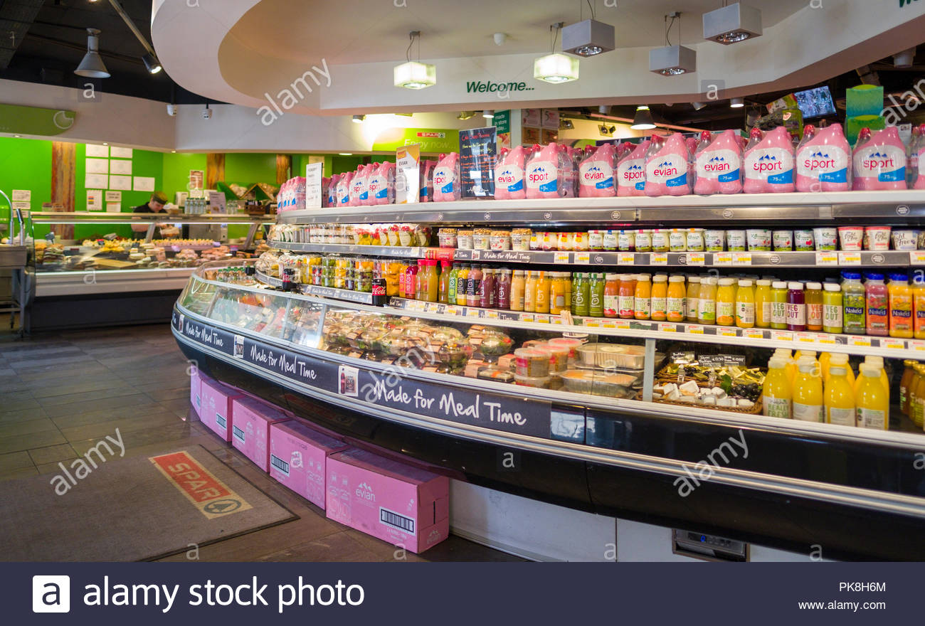 Deli and refrigerated display case with sandwiches and other food and drink items on sale in Spar convenience retail shop, Merrion Row, Dublin, Leinst - Stock Image