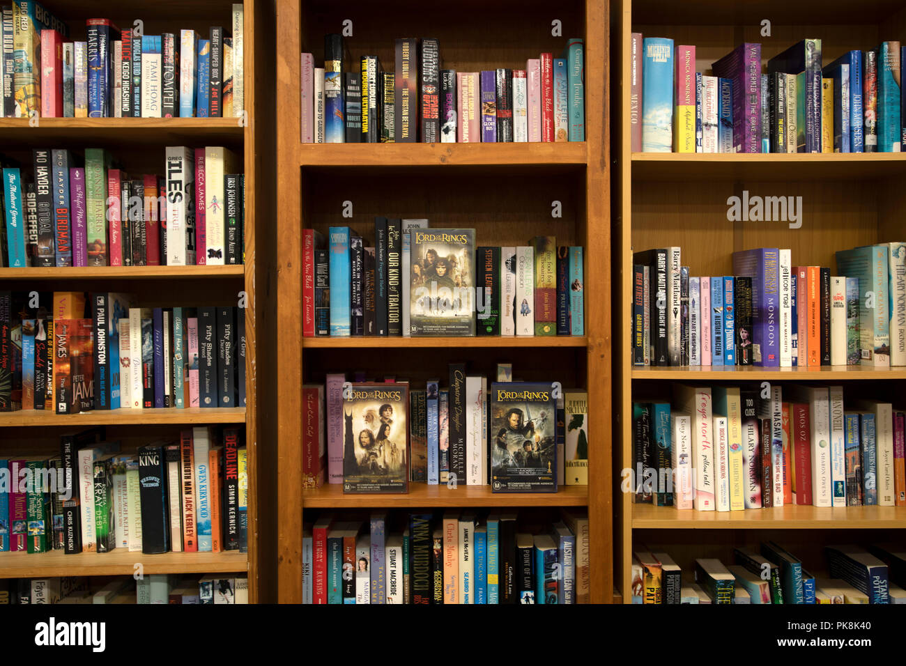 Library book shelves with the Lord of the Rings Trilogy - Stock Image