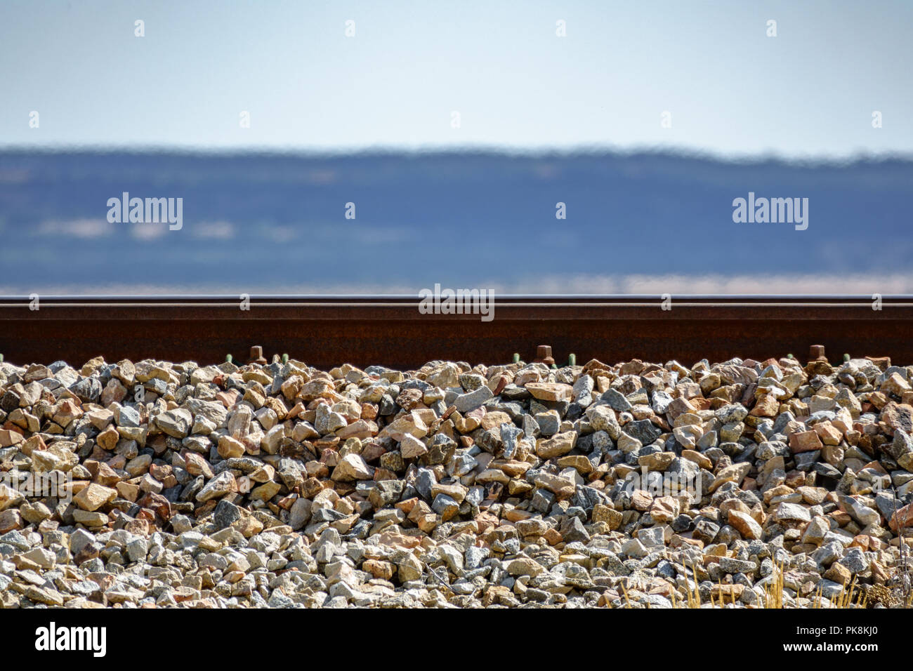Profile view of train rail on hot summer day - Stock Image