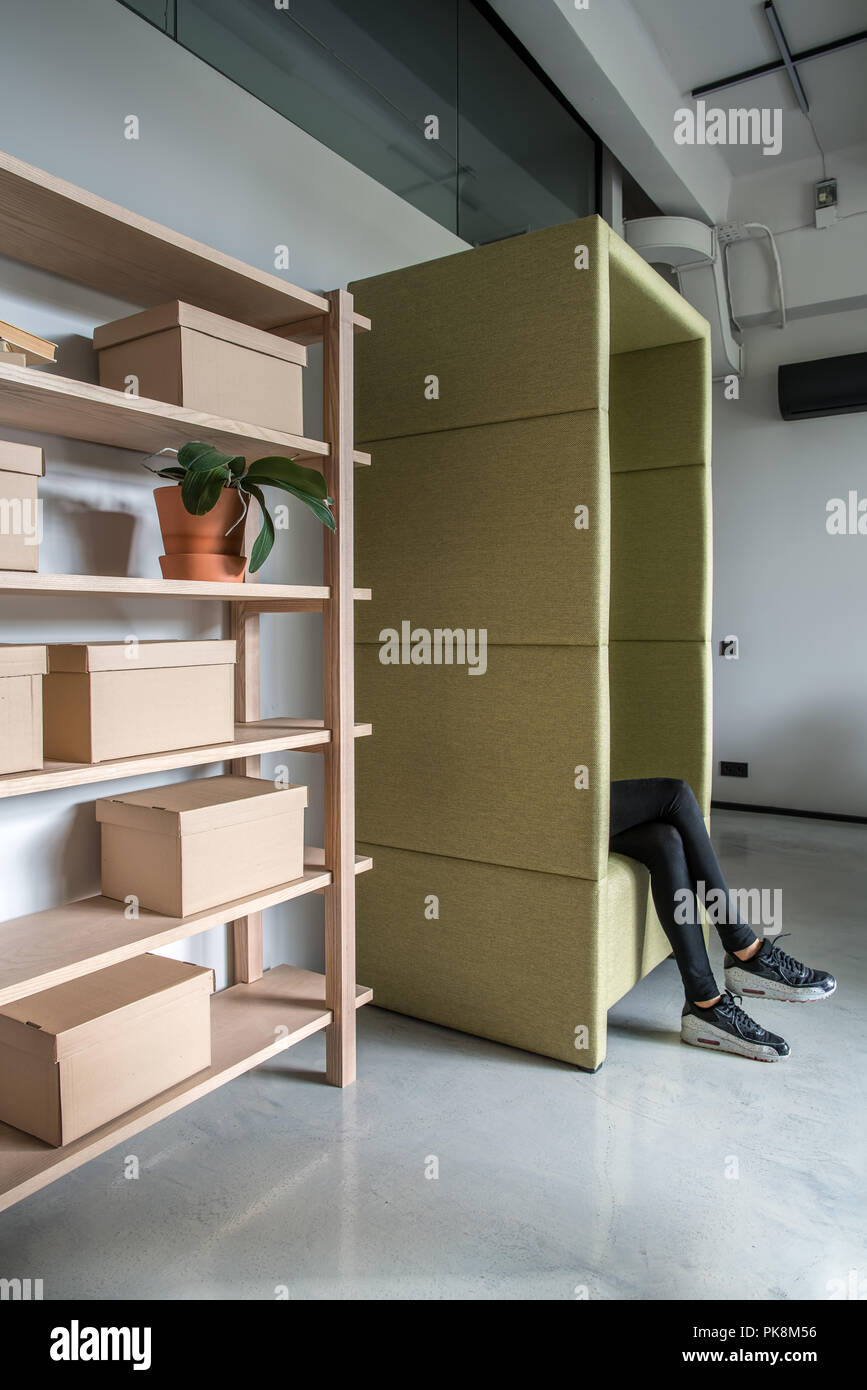Trendy office Relaxing Trendy Office In Loft Style With Gray Walls And Glossy Floor There Are Wooden Shelves With Cardboard Boxes And Plant In An Orange Pot Fancy Gr พนทสำนกงานใหเชา ออฟฟศใหเชา ขายอาคารสำนกงาน Trendy Office In Loft Style With Gray Walls And Glossy Floor
