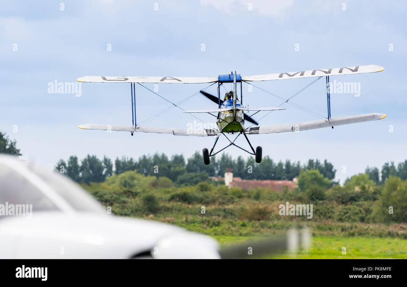 Spirit of Pashley, G-AMNN, a 2 seater Tiger-Moth Bi-plane coming into land. Vintage biplane landing in England, UK. - Stock Image