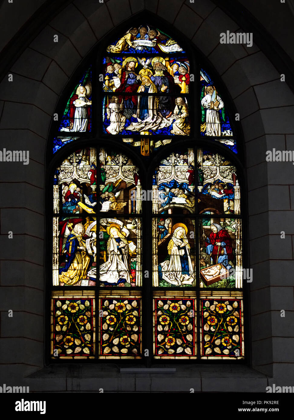 Medieval  stained glass window in Augsburg cCathedral, a romanesque basilica style Roman Catholic cathedral in Augsburg, Germany Stock Photo