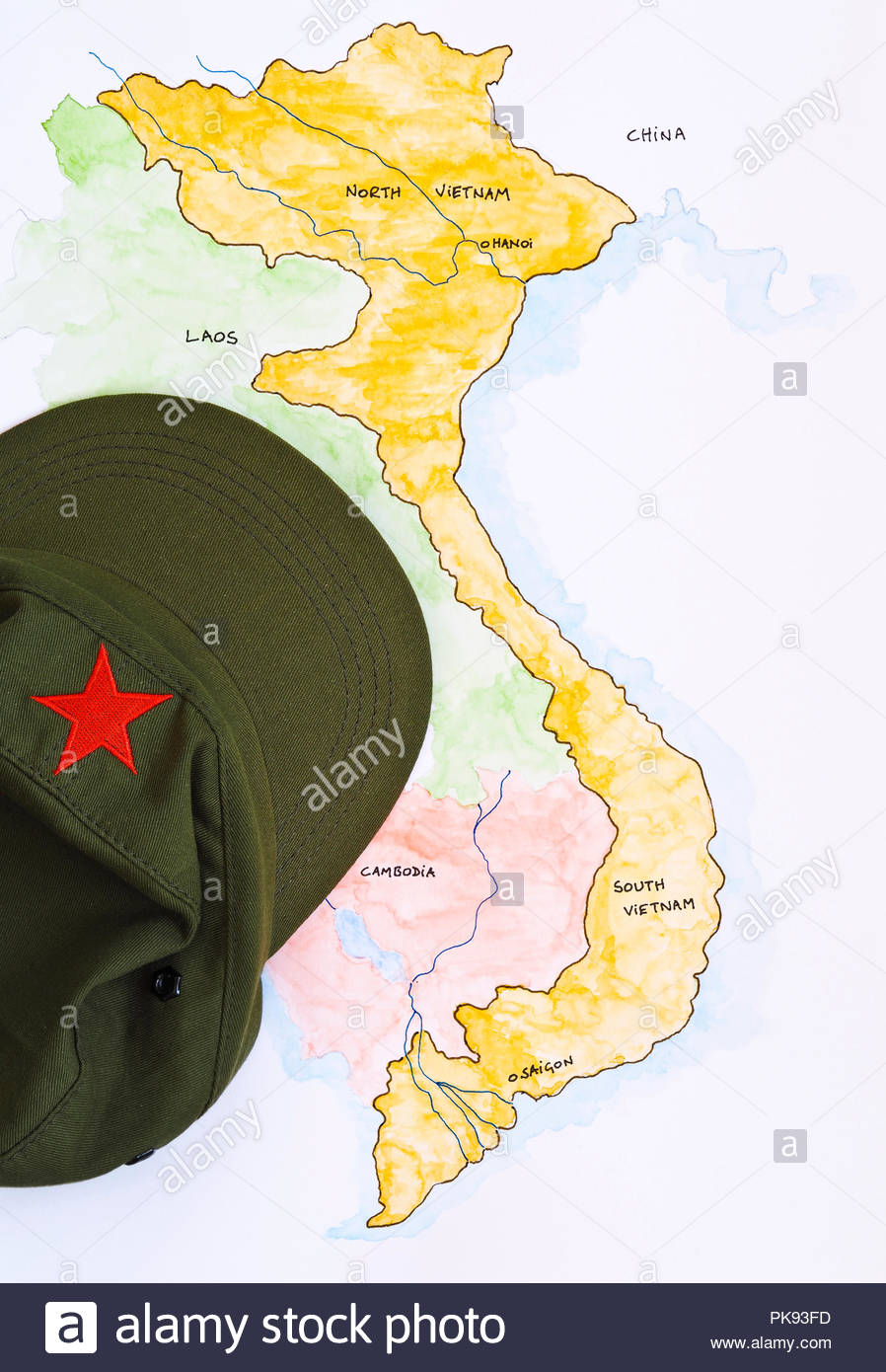Green peak hat with Red Star, on painted map of Vietnam, Indo-China Stock Photo