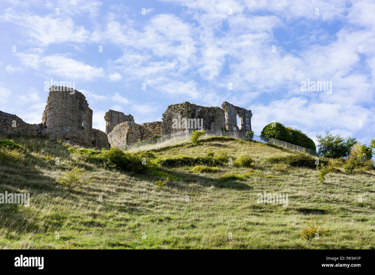 Corfe Castle, view of the castle ruins from the public road below, Dorset, UK - Stock Image