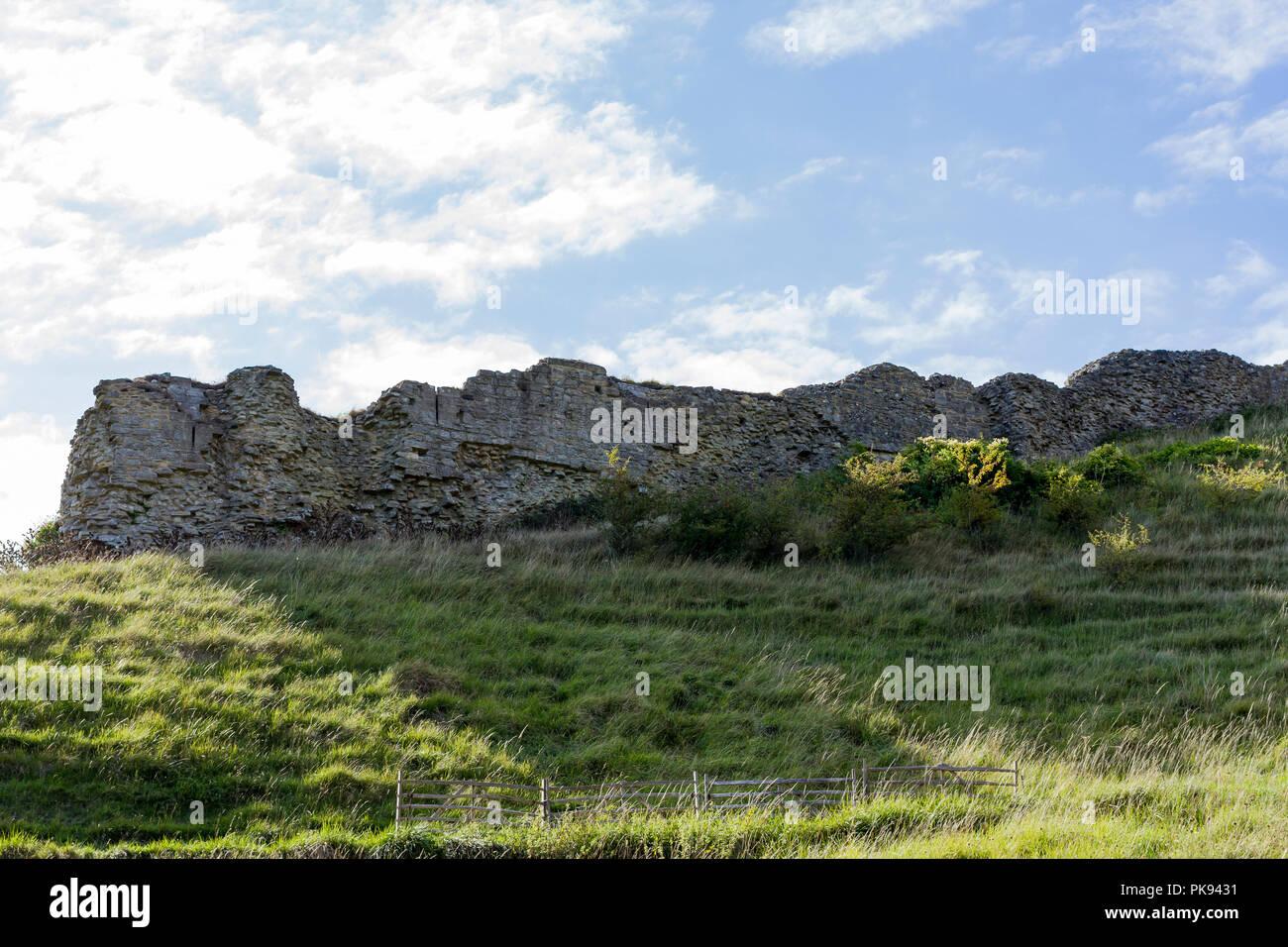 Corfe Castle ruins seen from the public road below, Dorset, UK - Stock Image