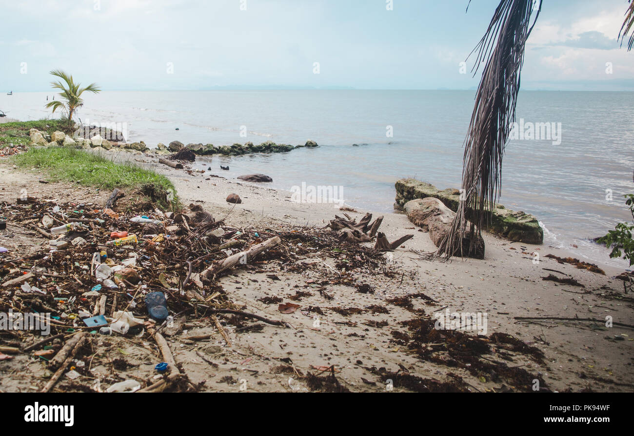 Paradise beach in Guatemala ruined by plastic litter washed up on the sand - Stock Image