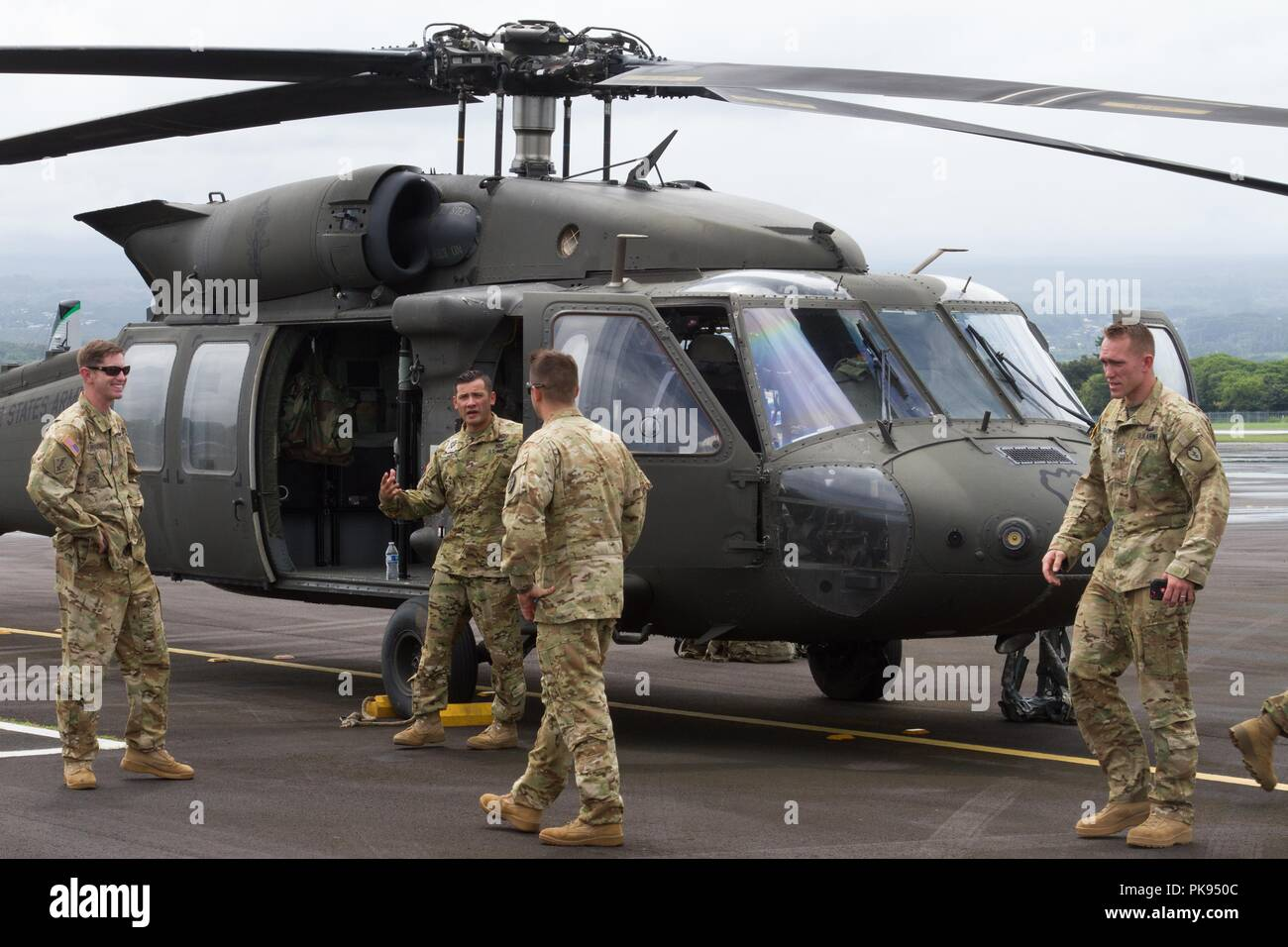 Soldiers from UH-60 Black Hawk flight crews, 25th Combat Aviation Brigade, 25th Infantry Division, Hawaii, prepare to provide Department of Defense support missions to the Federal Emergency Management Agency as part of Joint Task Force 5-0 on Aug. 26, 2018, August 26, 2018. This task force was established to respond to the effects of Hurricane Lane on the state of Hawaii. Local authorities and the State of Hawaii, through JTF 5-0, requested HH-60M Black Hawk helicopters with hoist capability to assist local authorities with recovery operations on the Isle of Hawaii. JTF 5-0 is a joint task for - Stock Image