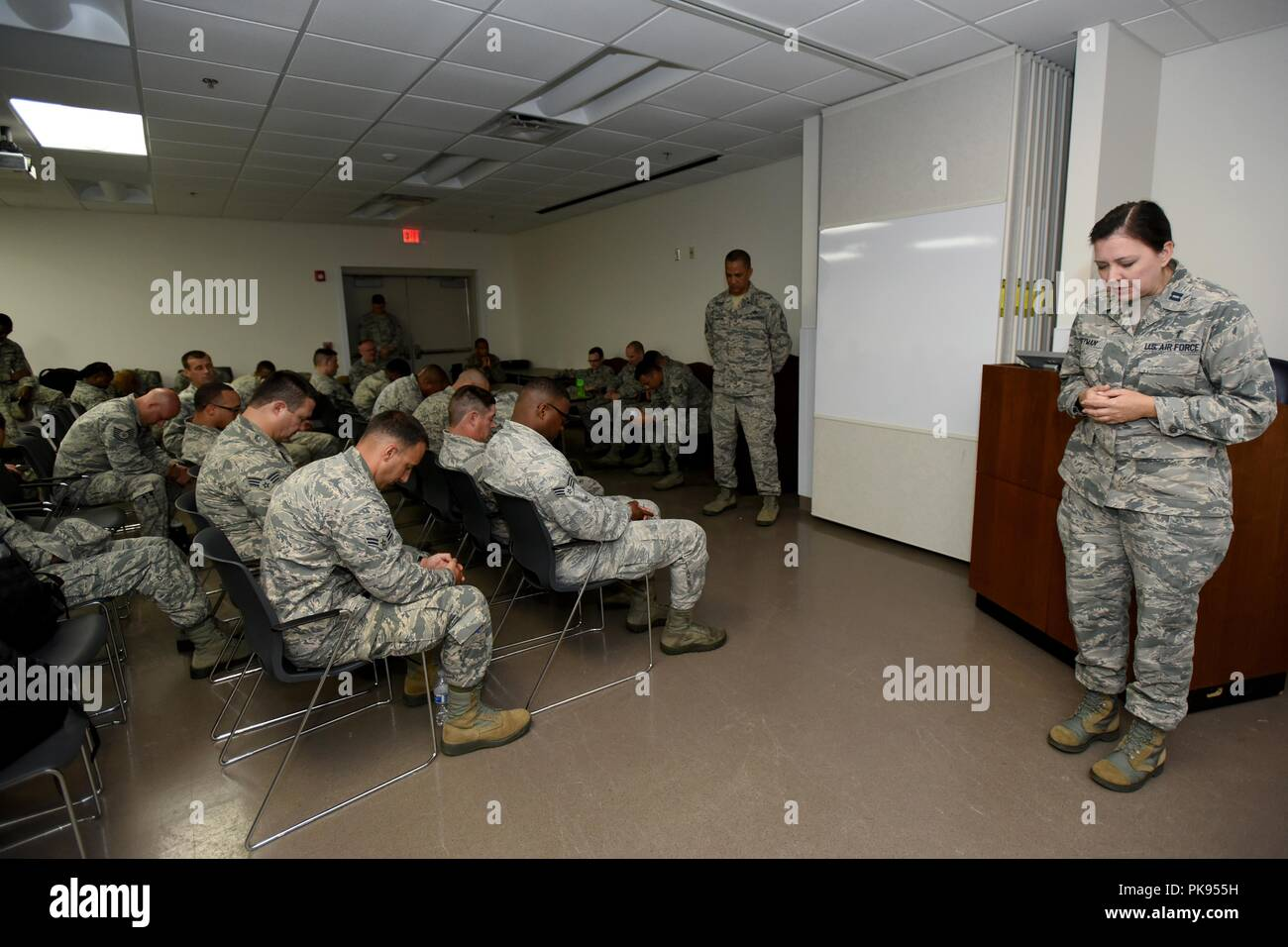 U.S. Air Force Capt. Christina Pittman, the 169th Fighter Wing chaplain prays with Airmen from the South Carolina Air National Guard as they prepare to deploy from McEntire Joint National Guard Base to Bluffton, South Carolina, to support partnered civilian agencies and safeguard the citizens of the state in advance of Hurricane Florence, September 10, 2018, September 10, 2018. Approximately 800 Soldiers and Airmen have been mobilized to prepare, respond and participate in recovery efforts as forecasters project Hurricane Florence will increase in strength with potential to be a Category 4 sto - Stock Image