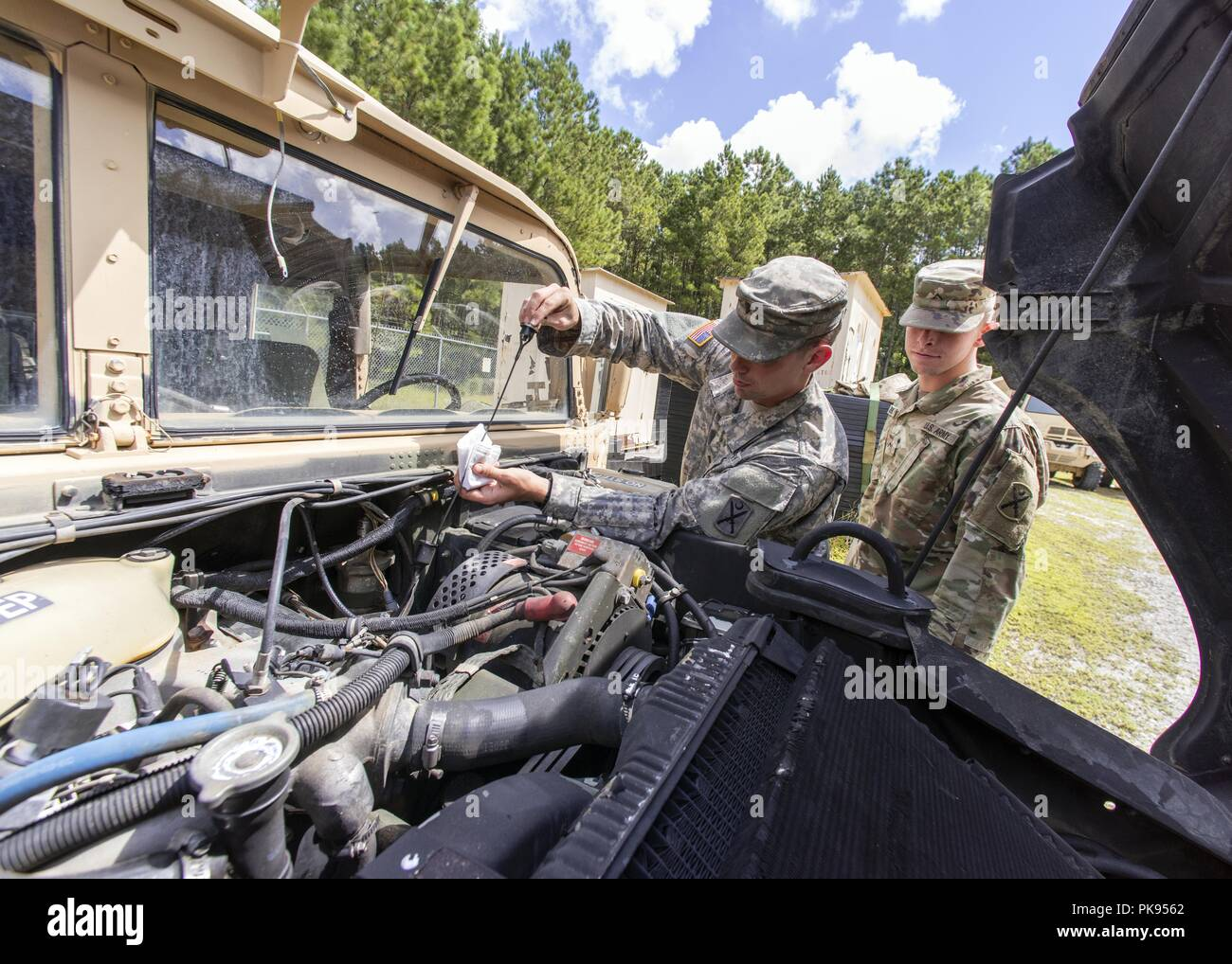 South Carolina National Guard Soldiers from Bravo Company, 1-118 Infantry, preform preventative maintenance checks to unit vehicles in preparation to support partnered civilian agencies and safeguard the citizens of the state in advance of Hurricane Florence, September 10, 2018, September 10, 2018. Approximately 1600 Soldiers and Airmen have been mobilized to prepare, respond and participate in recovery efforts as forecasters project Hurricane Florence will increase in strength with potential to be a Category 4 storm and a projected path to make landfall near the Carolinas and east coast. (U.S Stock Photo