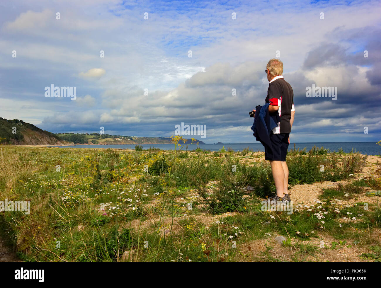 Holidaymaker enjoying the view at Strete Gate - Stock Image