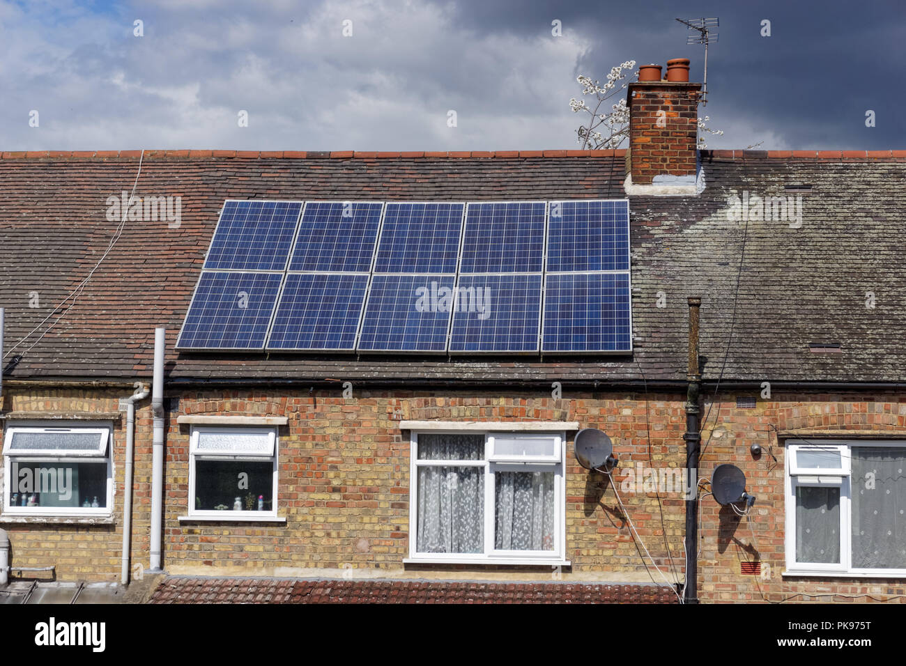 House with solar panels in London, England, United Kingdom, UK - Stock Image