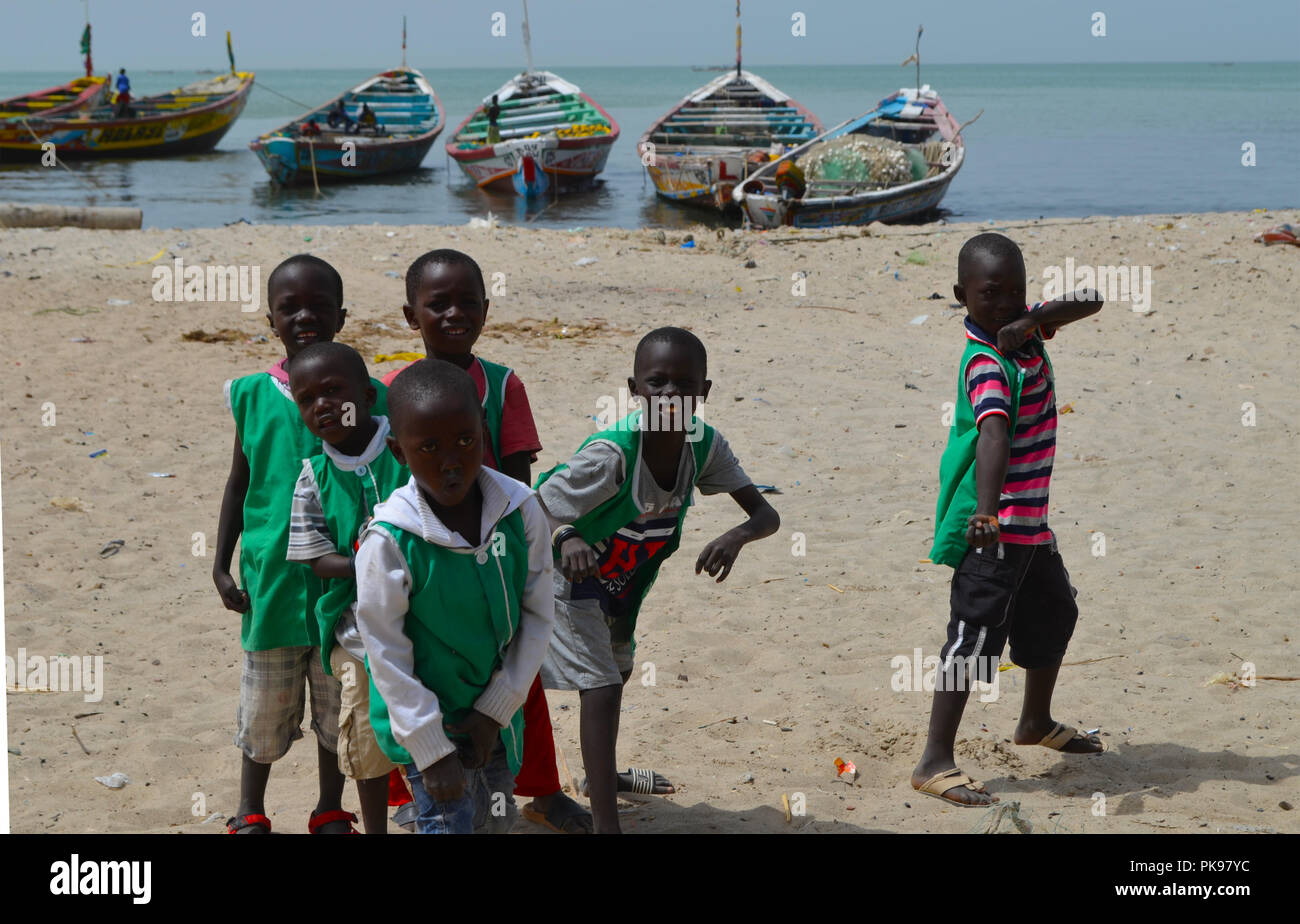 Sustainable Development Goals: kids in the beach, during school time,  Joal-Fadiouth (Senegal) - Stock Image