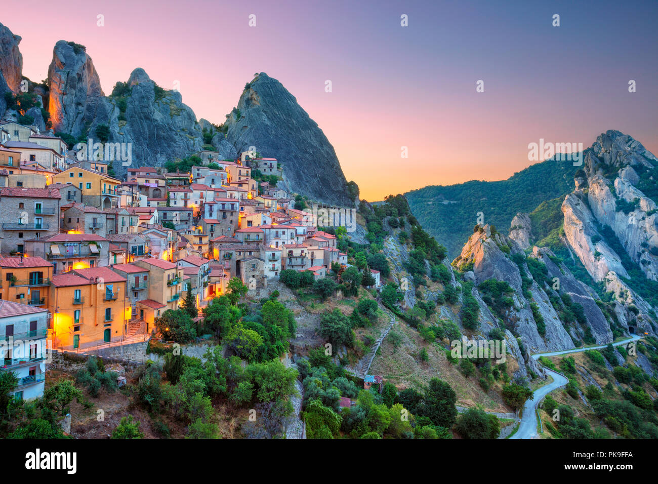 Castelmezzano, Italy. Cityscape aerial image of medieval city of Castelmazzano, Italy during beautiful sunrise. Stock Photo