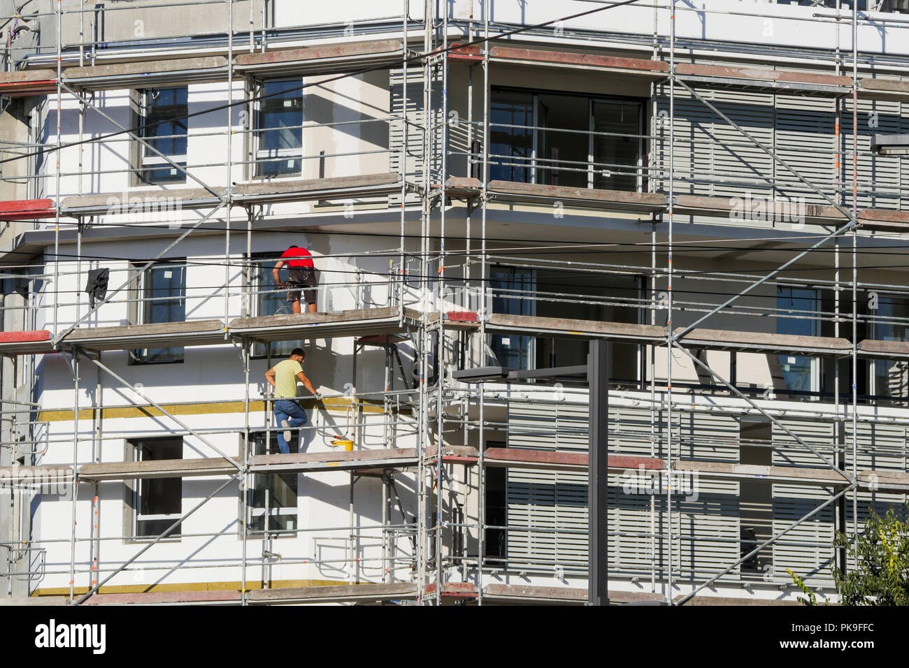 Installing insulation on a new built building, Bron, France Stock Photo