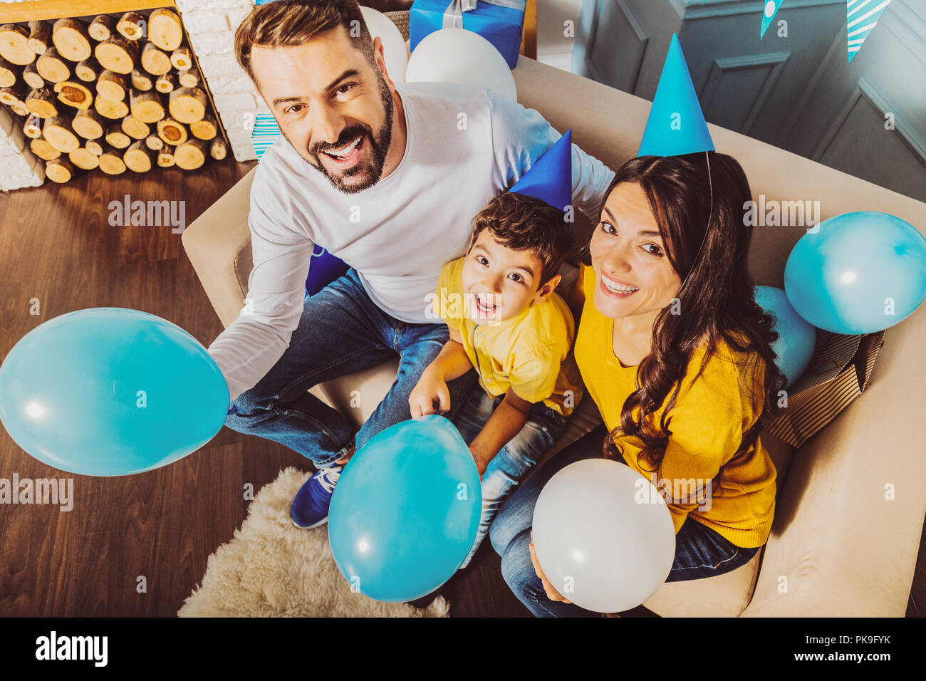 Pleasant merry family having birthday party - Stock Image