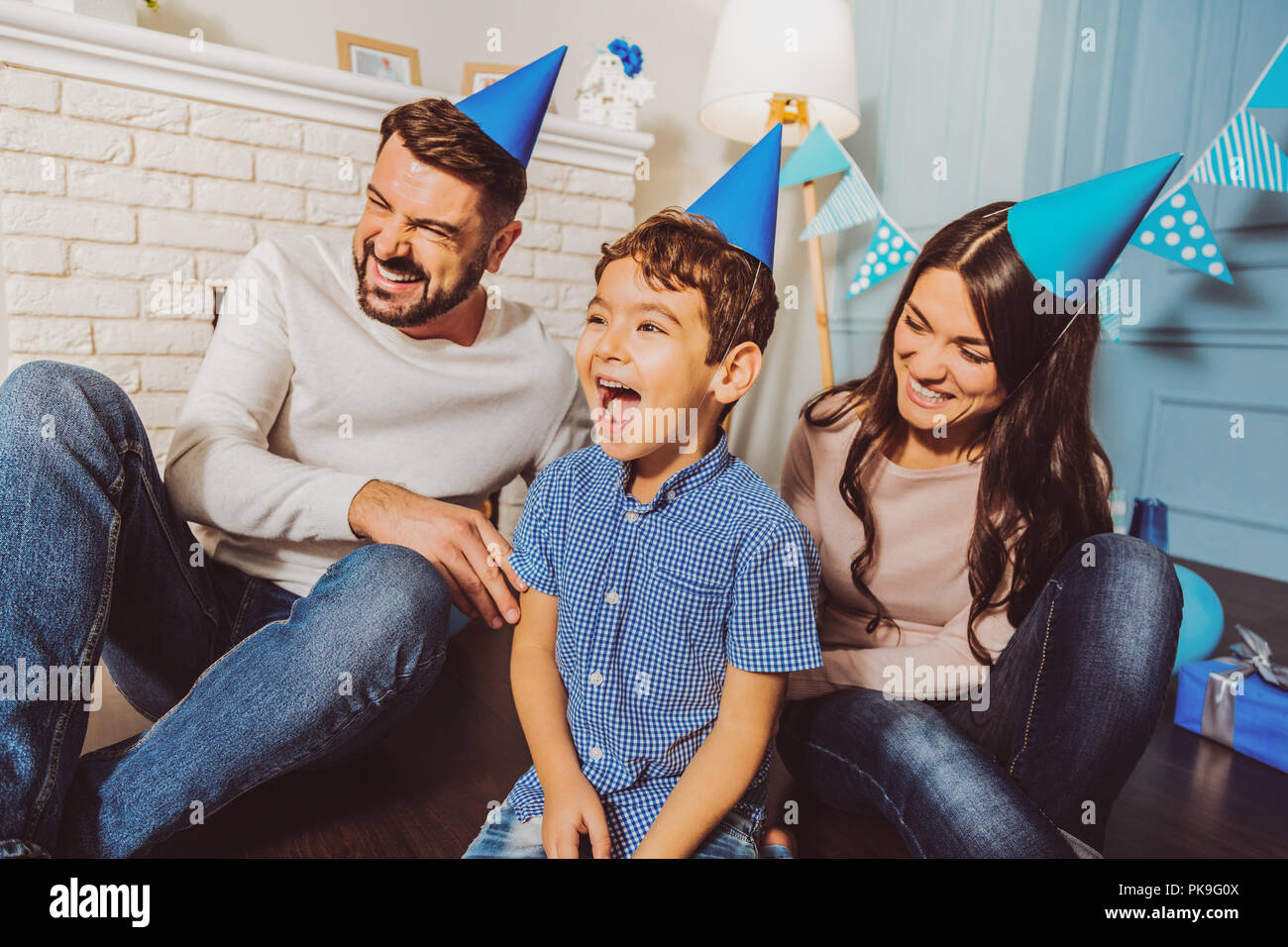 Happy merry family rejoicing birthday party - Stock Image