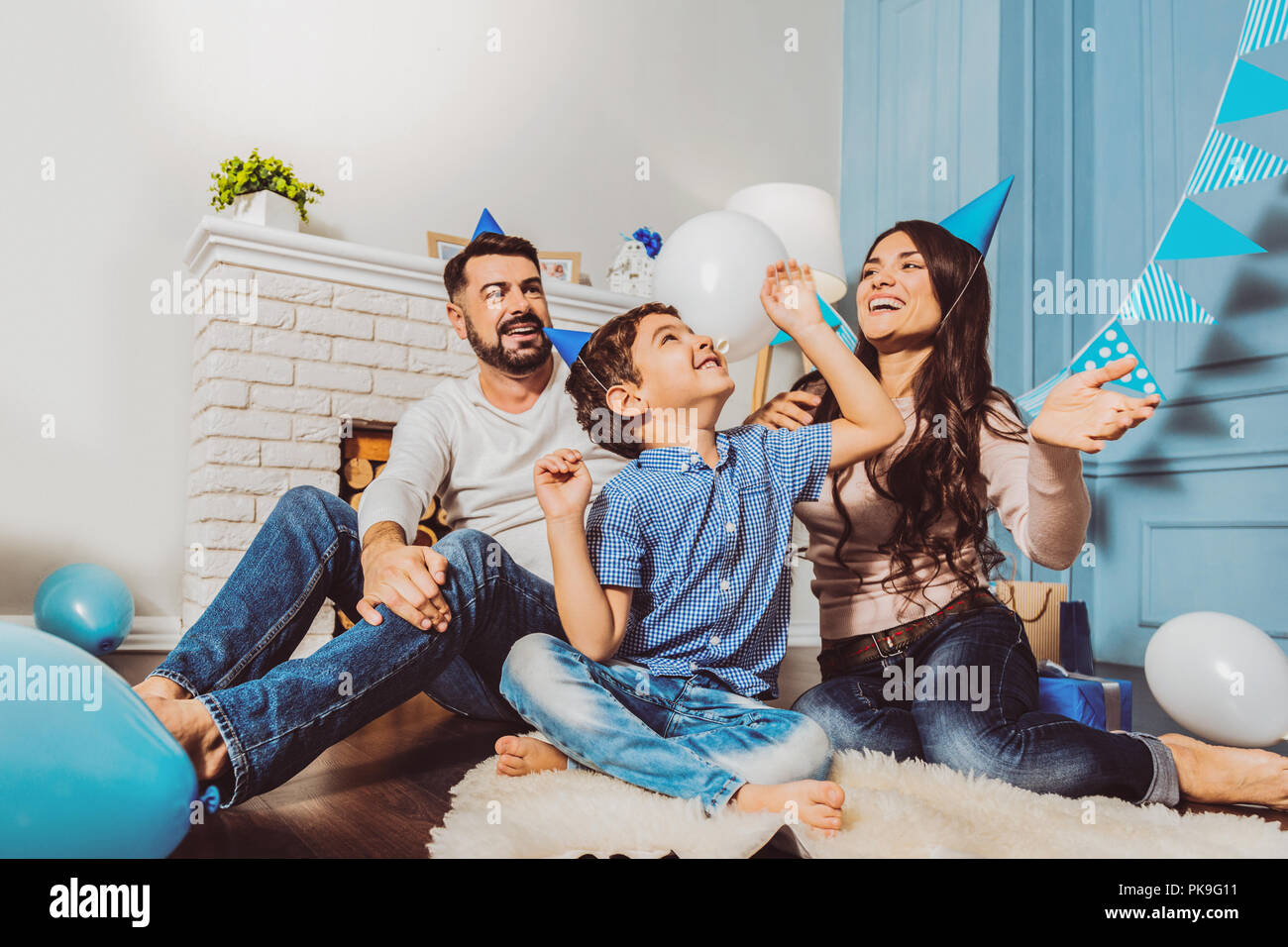 Cheerful sweet family spending birthday party - Stock Image