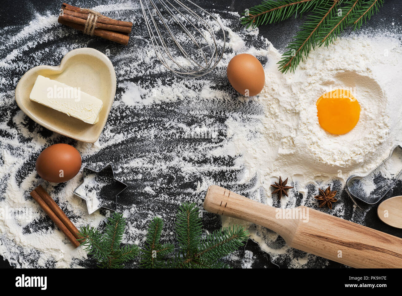Christmas background with ingredients for baking on a black concrete background. Top view, copy space,flat lay. - Stock Image