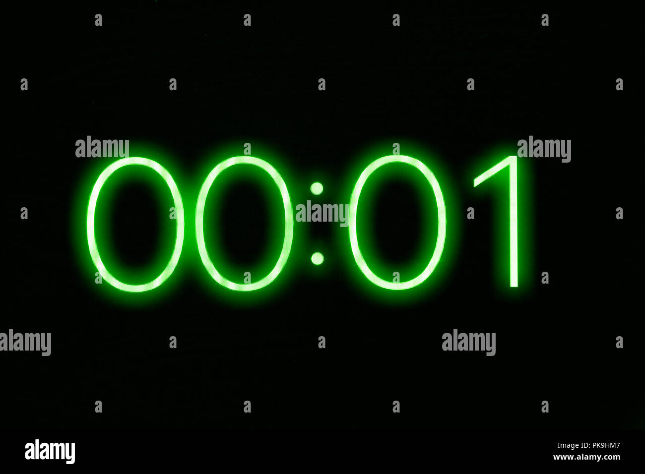 Digital clock timer stopwatch display showing 1 one second remaining. Emergency, urgency, out of time concept. - Stock Image