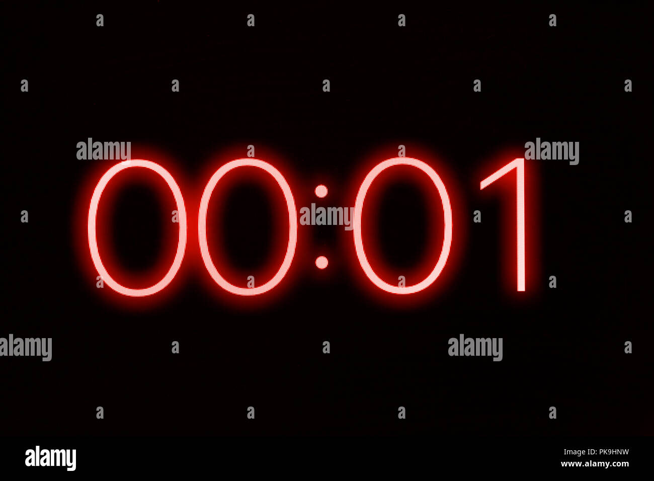 Digital clock timer stopwatch display showing 1 one second remaining. Emergency, urgency, out of time concept. Stock Photo