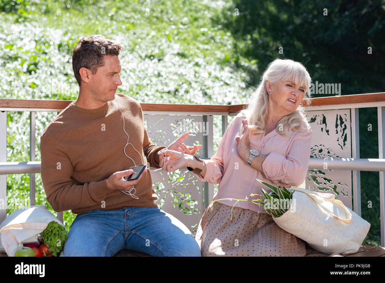 Attentive male person looking at strange woman - Stock Image