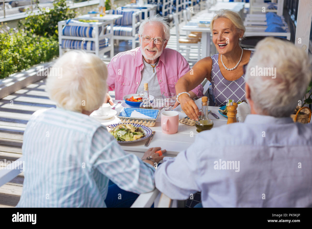 Delighted elderly people enjoying their time together - Stock Image