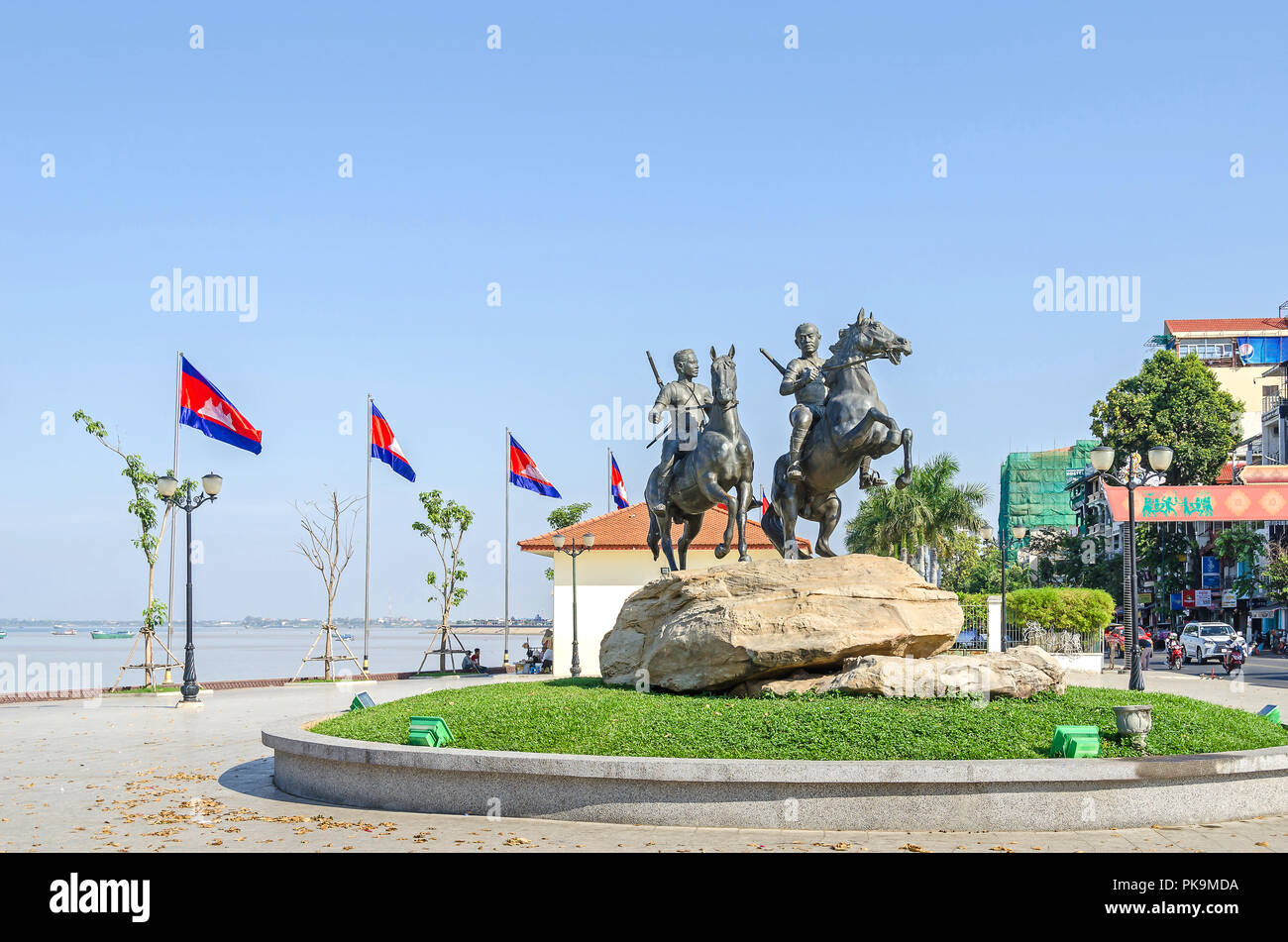 Phnom Penh, Cambodia - April 9, 2018: View of the Preah Sisowath Quay with the horse monument to the warriors Techo Meas and Techo Yot Stock Photo