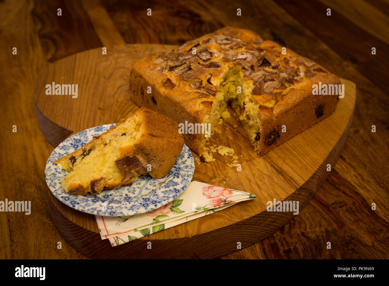 Apple Cake On Heart Shaped Chopping Board Wooden Table One Slice Cut Side Plate With Napkin
