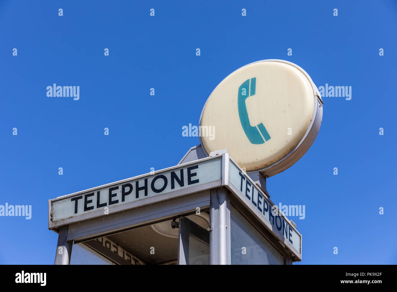 Telephone sign on phone booth; California, USAStock Photo