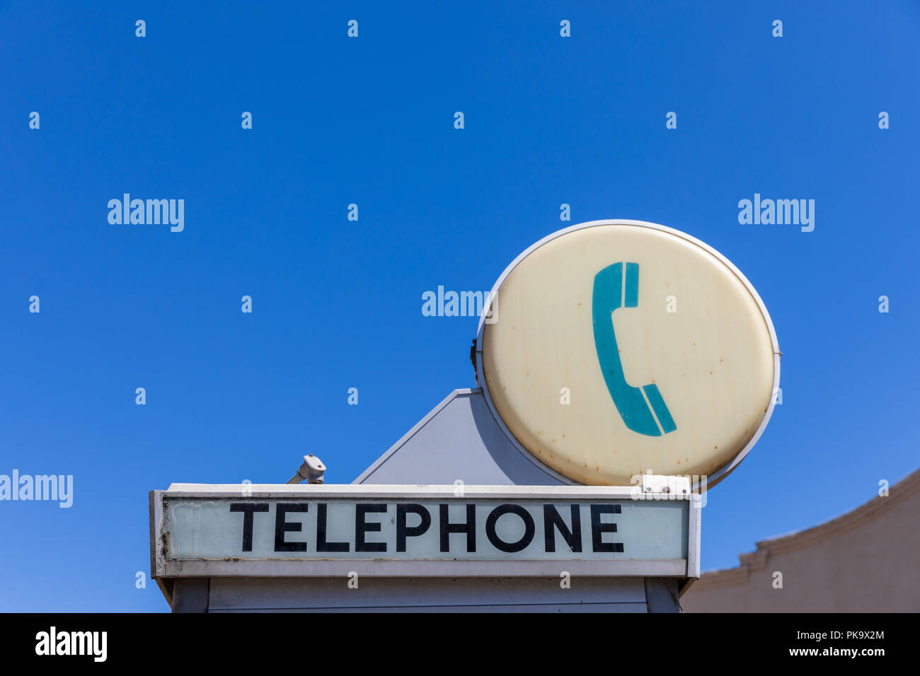 Telephone sign on phone booth; California, USA Stock Photo