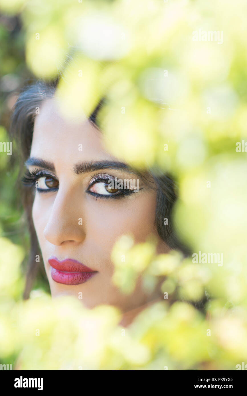Serious woman in the garden - Stock Image