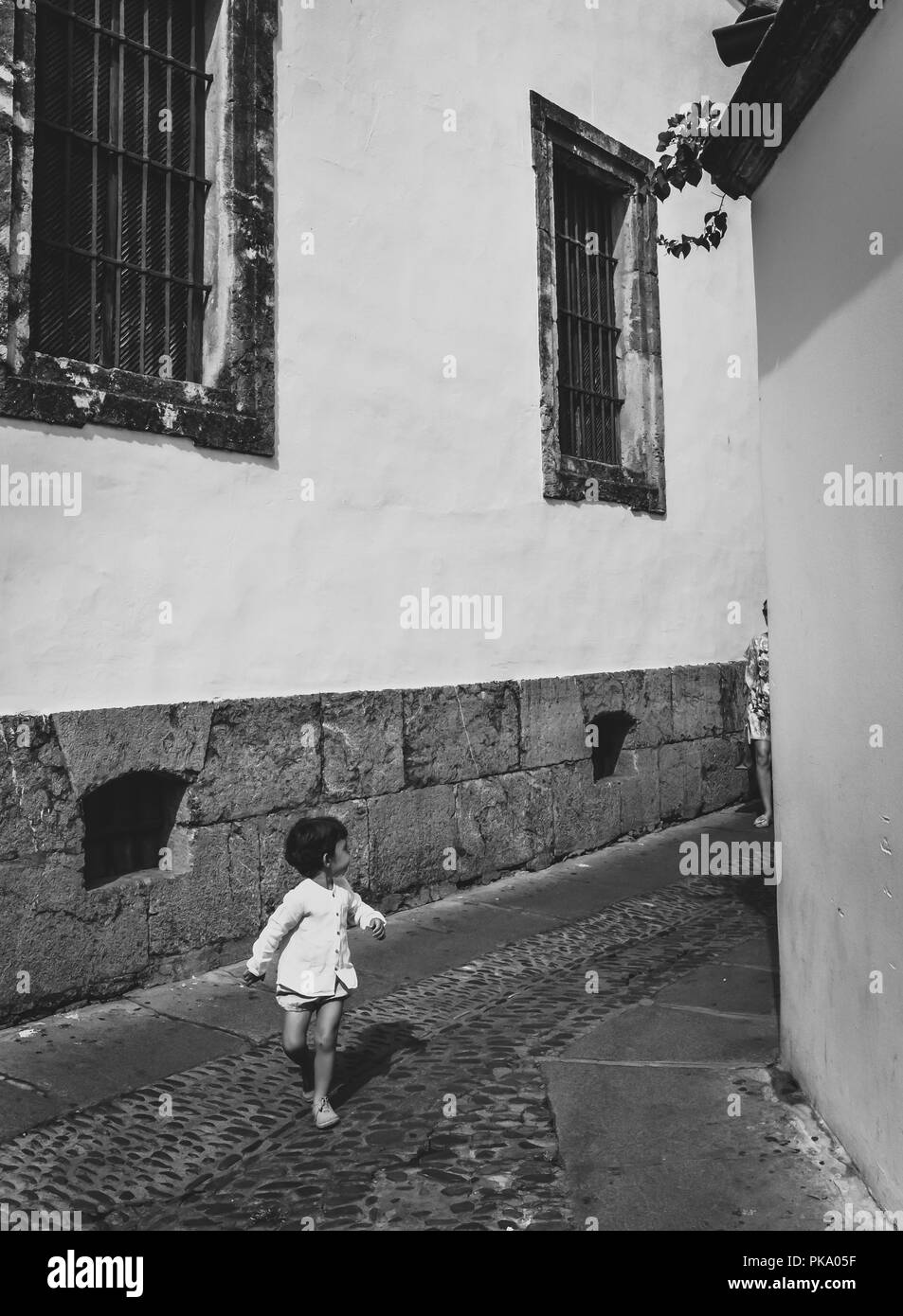 Cordoba/ Spain - 08/20/18 - Children running the old town area of Cordoba - Spain - Stock Image