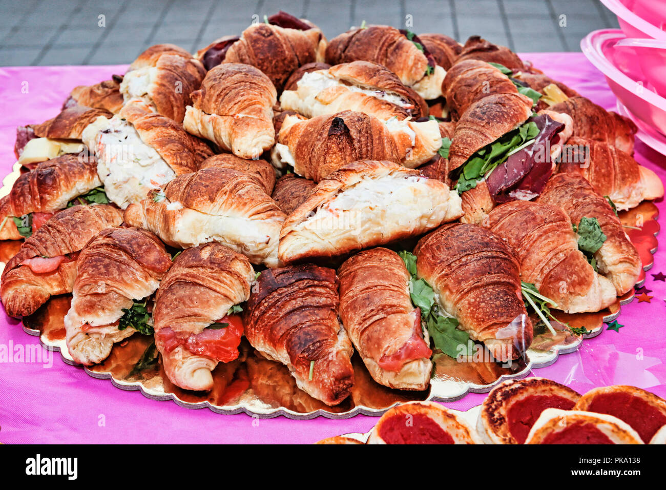 Serving dish with many stuffed salted croissants - selective focus - Stock Image