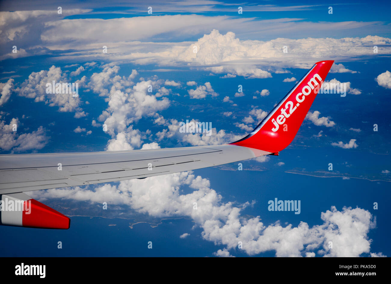 Boeing 737-800 cabin view of a Jet2 budget airline winglet - Stock Image