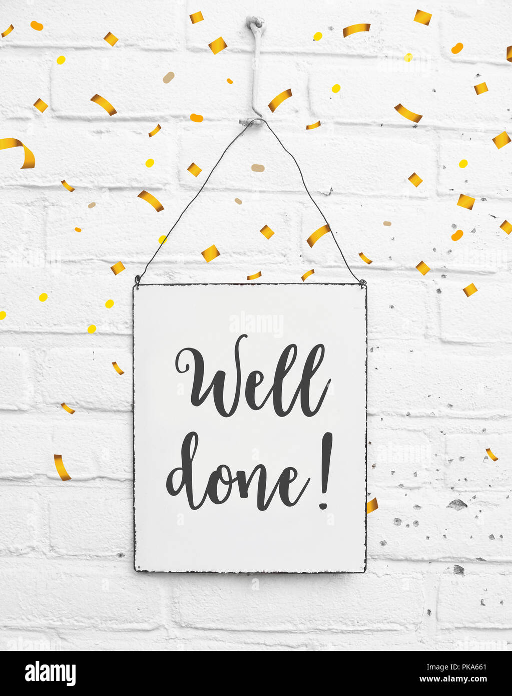 Text well done congratulations on white metal plate with confetti - Stock Image