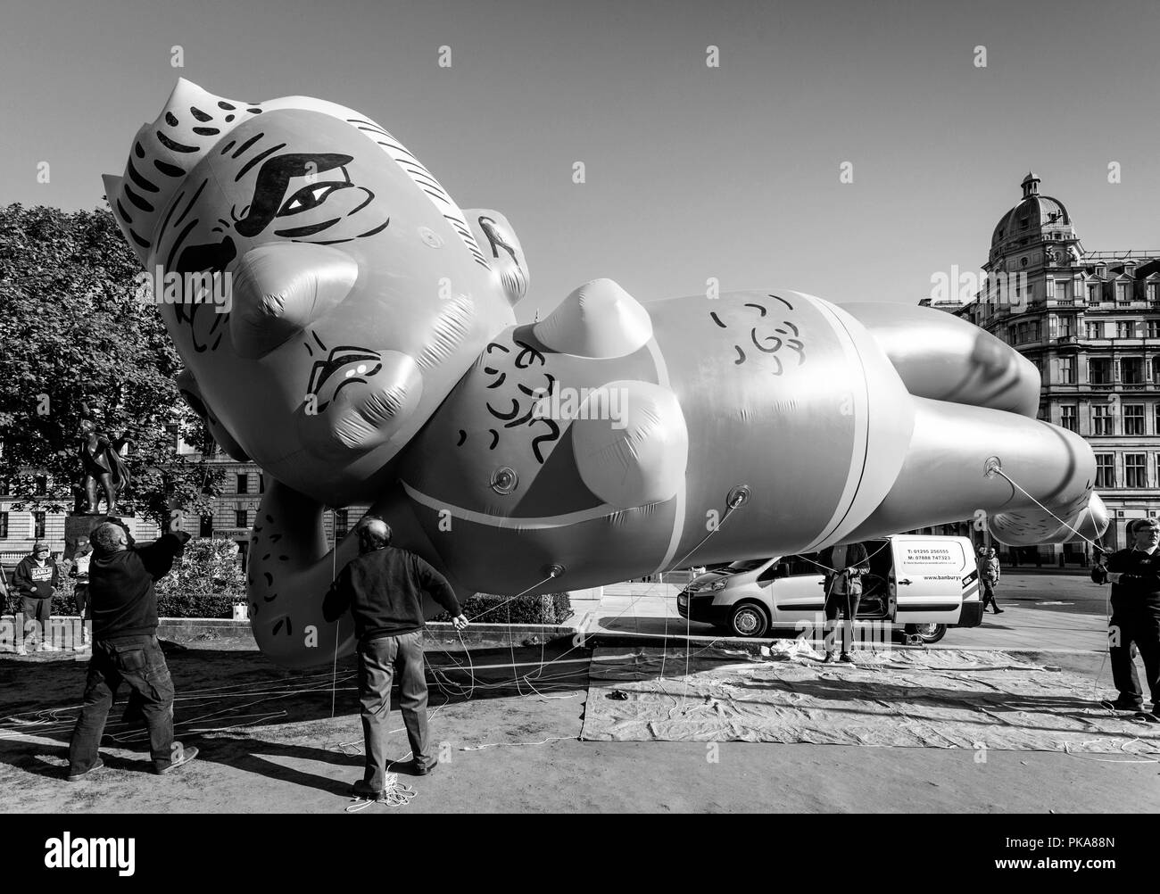 Protesters Fly a 29ft Long Bikini-Clad Blimp of London Mayor Sadiq Khan Over Parliament Square, London, UK - Stock Image