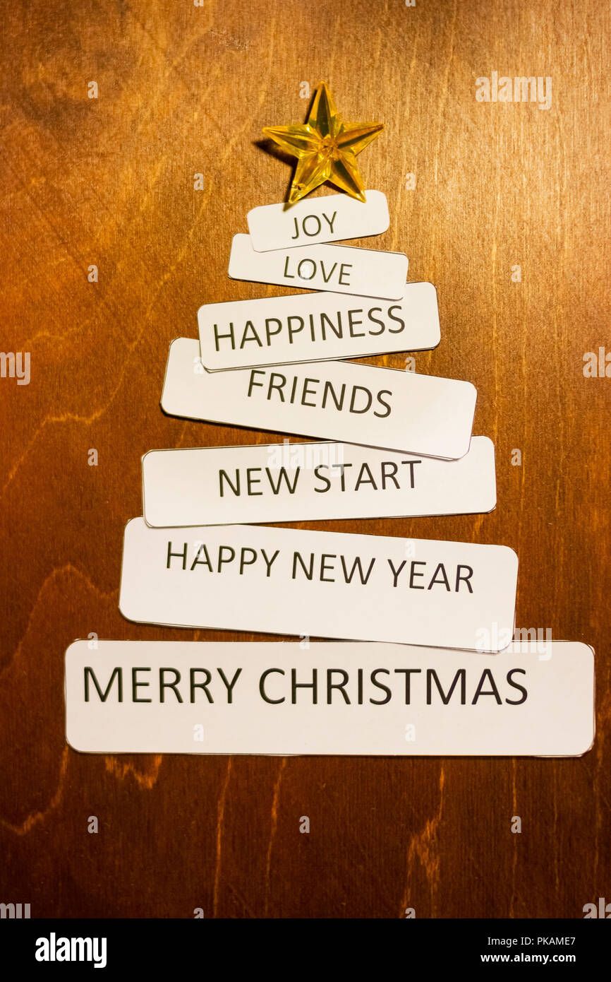 710122c466f Christmas Wish List, New year Wish List, message,post card for happy  holidays on wooden background.Christmas tree made from holidays letterings.