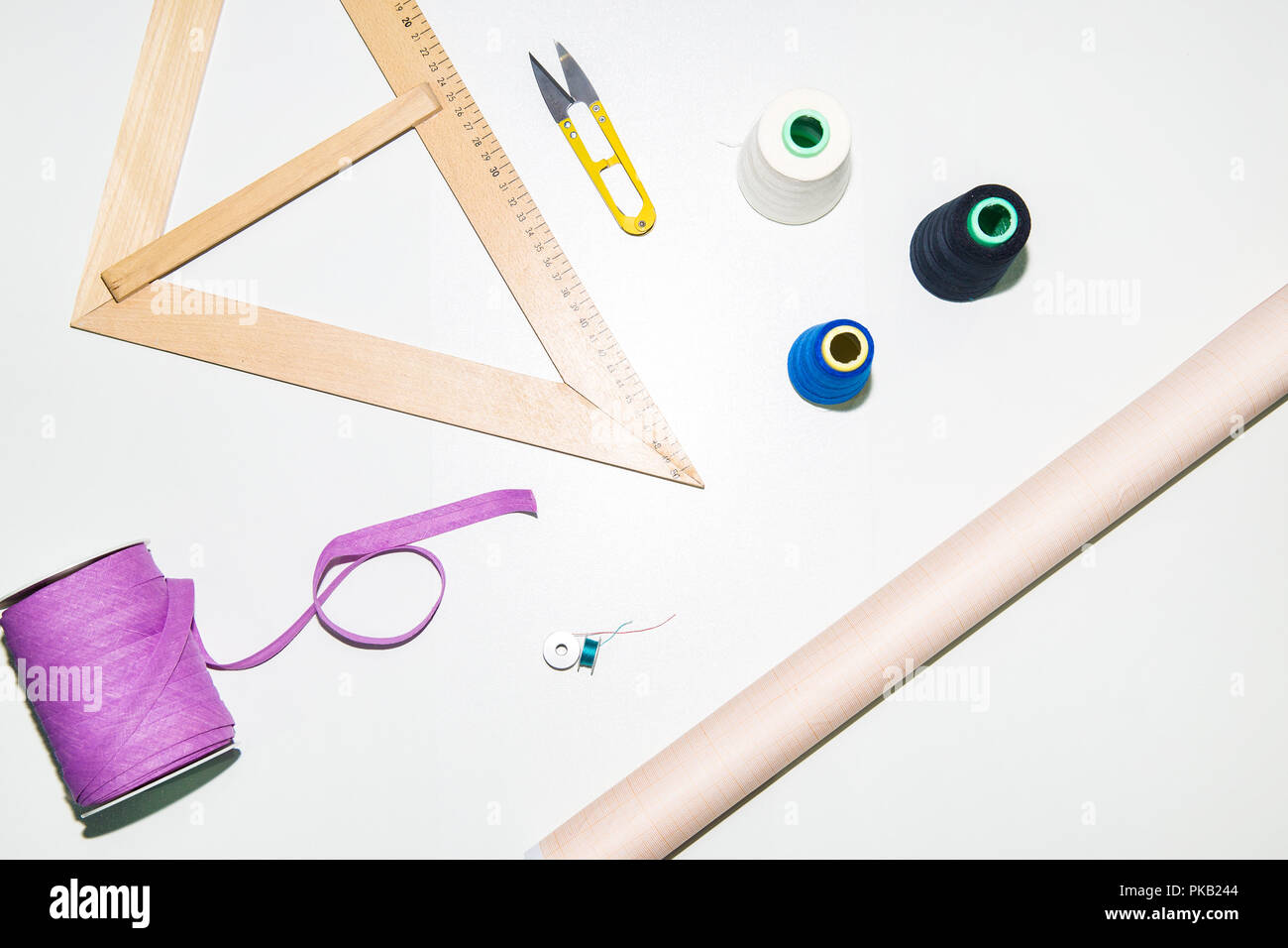 Accessories for seamstresses and needlework top view ruler of thread scissors tape, Background - Stock Image