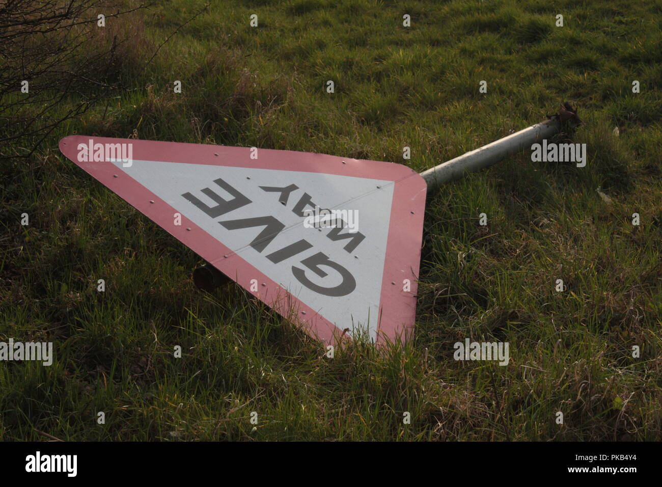 fallen road sign - Stock Image